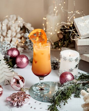 orange juice with ice and dried orange on top