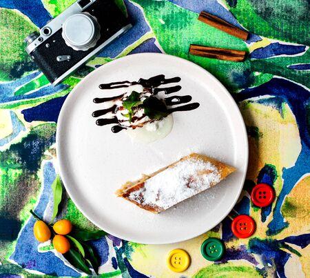 pie with sugar powder and ice cream with chocolate on 版權商用圖片