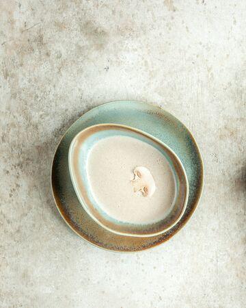 mushroom soup in blue plate