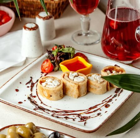 sliced rolls with fish and sweet chili with compote Stok Fotoğraf