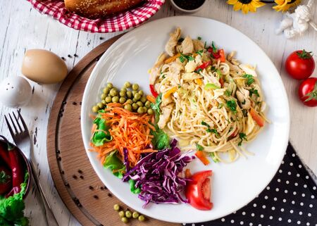 spaghetti with sliced vegetables and beans
