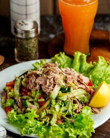 tuna salad and glass of juice
