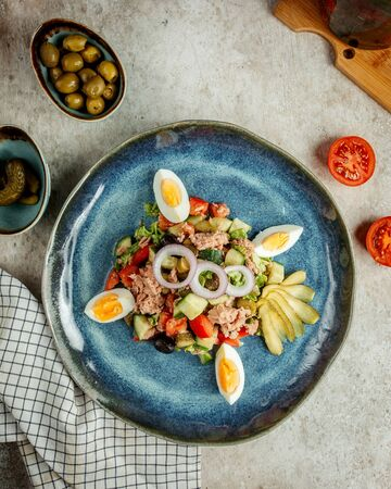 tuna salad with sliced eggs and pickles