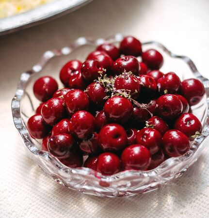 a glass plate with cherries