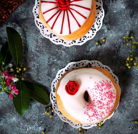 a pair of donuts with painting on top Stok Fotoğraf
