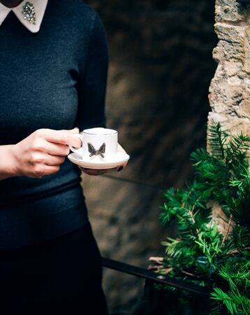 a person holding a cup of coffee Stok Fotoğraf