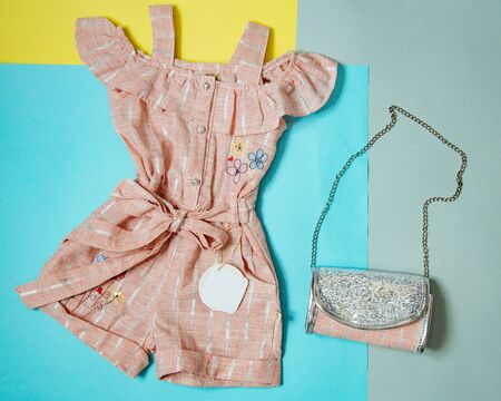 pink jumpsuit and pink chain handbag