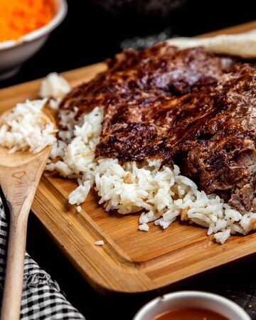 juicy well-done meat on a rice pad