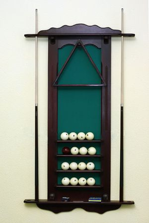 snooker hall: The wooden support for billiard spheres hangs on a wall  Stock Photo