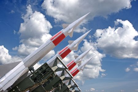 armaments: Four rockets of a surface-to-air missile system are aimed in the sky