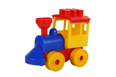 Colourful plastic toy train it is isolated on the white photo