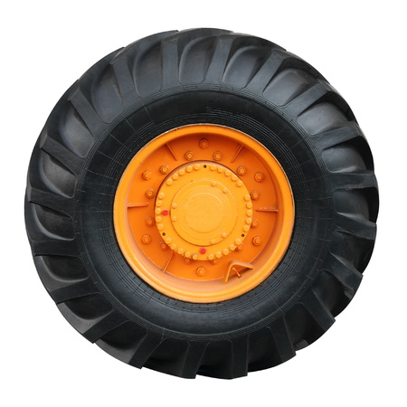 Tractor tire on white background ( isolated with paths) photo