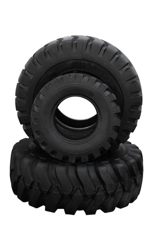 Three tractor tyre covers separately on a white background photo