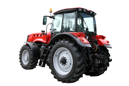 agricultural engineering: Red tractor separately on a white background