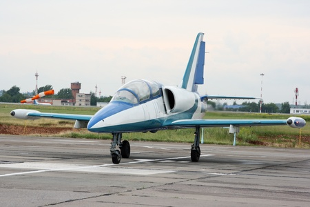 maneuverable: The small jet plane on an airfield