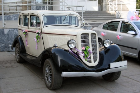 The old car decorated with wedding colours photo
