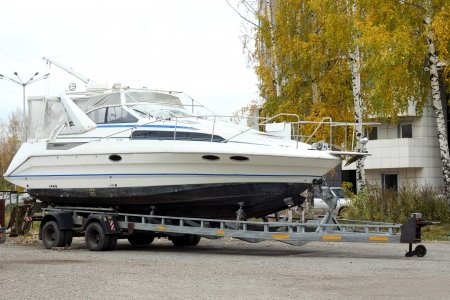 boat trailer: The big motor yacht is loaded on a trailer