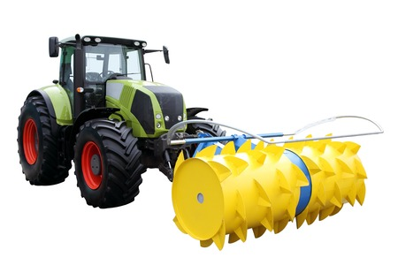 agricultural engineering: Green tractor separately on a white