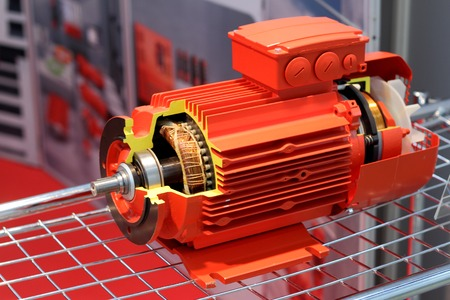 The red electric motor is presented in a cut Stock Photo