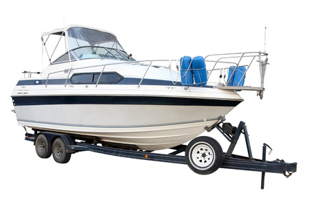The motor yacht on the trailer for transportation is isolated on a white background