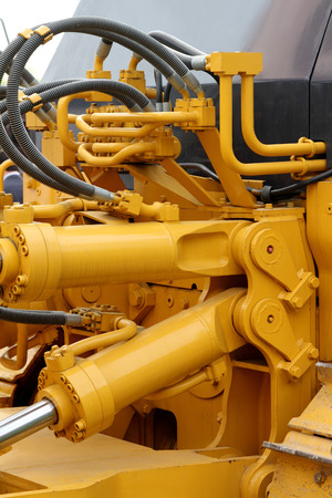 hydraulic: Hydraulic hoses and pistons of a modern tractor