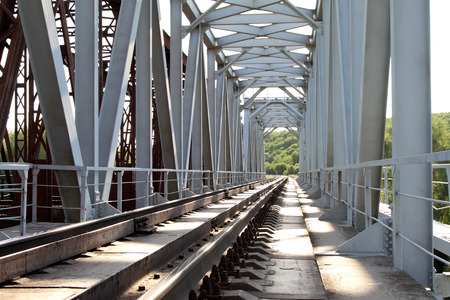 rail cross: Rails of the railway way which are passing through the bridge.