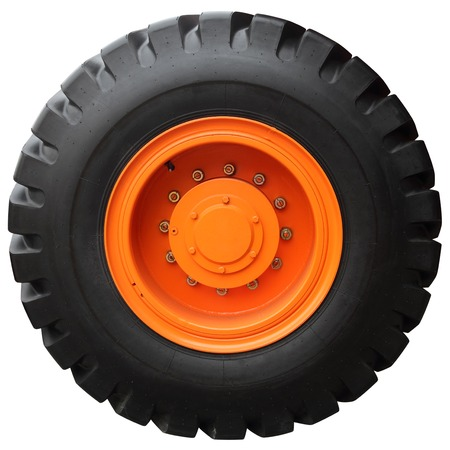 wheel tractor: The orange wheel tractor isolated on white background
