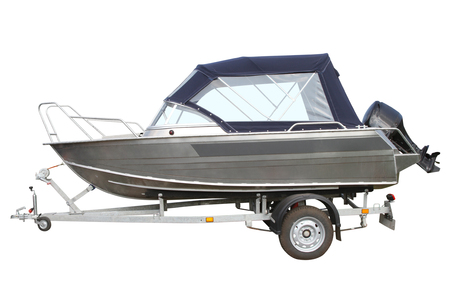 an awning: Motor boat with awning on the trailer for transportation