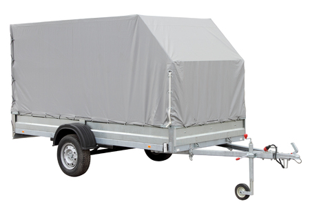 tarpaulin: Tarpaulin car trailer, isolated on white background. Stock Photo