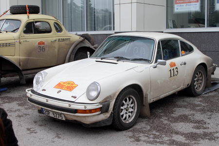 next stage: PERM, RUSSIA - JUNE 29, 2016: Rally of retro-cars Peking-Paris 2016 , June 29, 2016 in Perm, Russia. Porsche 911 is in the city after the next stage.
