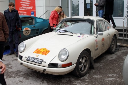 next stage: PERM, RUSSIA - JUNE 29, 2016: Rally of retro-cars Peking-Paris 2016 , June 29, 2016 in Perm, Russia. White Porsche 911 is in the city after the next stage.