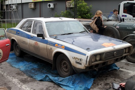 next stage: PERM, RUSSIA - JUNE 29, 2016: Rally of retro-cars Peking-Paris 2016 , June 29, 2016 in Perm, Russia. White Leyland P76 is in the city after the next stage.