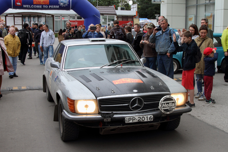 onlooker: PERM, RUSSIA - JUNE 29, 2016: Rally of retro-cars Peking-Paris 2016 , June 29, 2016 in Perm, Russia. The inhabitants of the city greeted the car participating in the rally.