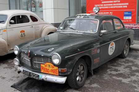 perm: PERM, RUSSIA - JUNE 29, 2016: Rally of retro-cars Peking-Paris 2016 , June 29, 2016 in Perm, Russia. Cars participating in the rally are near the hotel. Editorial