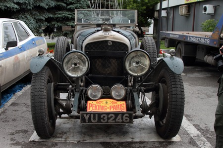 next stage: PERM, RUSSIA - JUNE 29, 2016: Rally of retro-cars Peking-Paris 2016 , June 29, 2016 in Perm, Russia. Bentley Le Mans is near the hotel after the next stage. Editorial