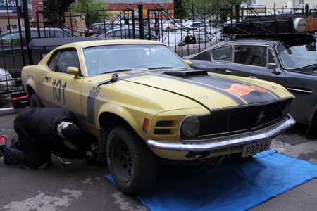 rarity: PERM, RUSSIA - JUNE 29, 2016: Rally of retro-cars Peking-Paris 2016 , June 29, 2016 in Perm, Russia. Participant rally Ford Mustang repairs.