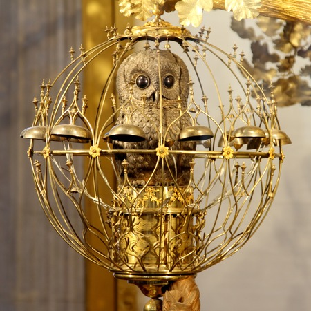 hermitage: SAINT-PETERSBURG, RUSSIA-JANUARY 06, 2017: Owl in the cage - the character of the hours Golden peacock. The pavilion hall of the State Hermitage Museum, St. Petersburg, Russia.