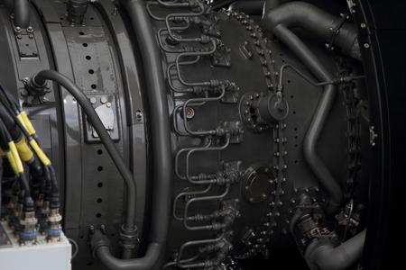 Fuel line of a modern turbofan aircraft engine closeup.