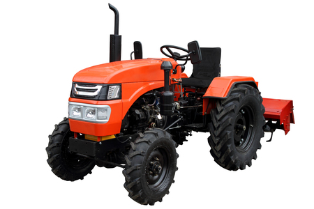 Red compact tractor with attached cultivator.