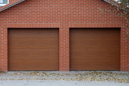 Brick garage for two cars with automatic gates. Banco de Imagens