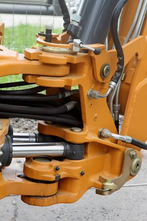 Swivel and hydraulic hoses on a modern tractor.