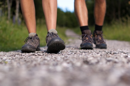 hiking boot: Closeup of two pairs of hiking shoes on a trail Stock Photo