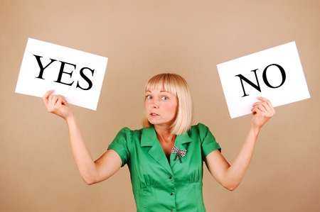 answer: Young woman with a Yes No signs