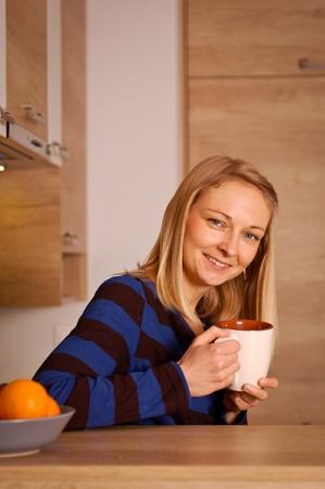 happieness: Young woman enjoying her tea break
