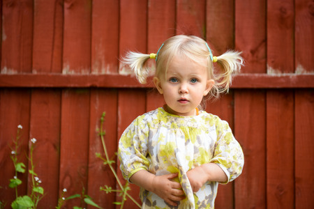 Beautiful little girl with tails outdoors in a sunny day Banque d'images
