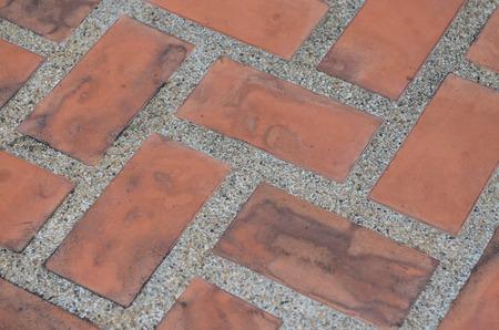 sidewalks: dirty old orange brick
