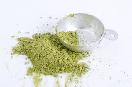maccha: green powder isolated on white background Stock Photo