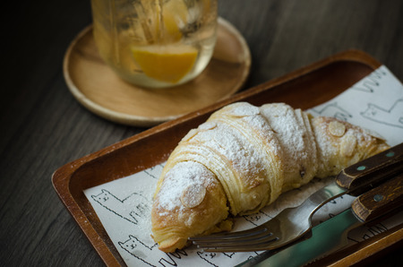 Croissants on wooden background Stock Photo