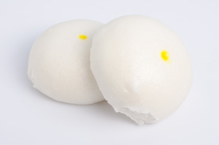 half stuff: Salapao steamed Chinese bun isolated on white background.