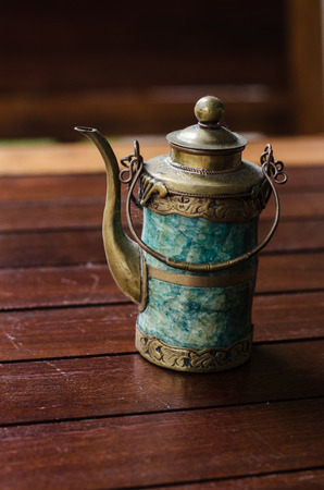 Traditional Turkish tea set: cup with teapot on wooden table